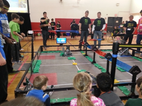Kids competing at Robotics competition